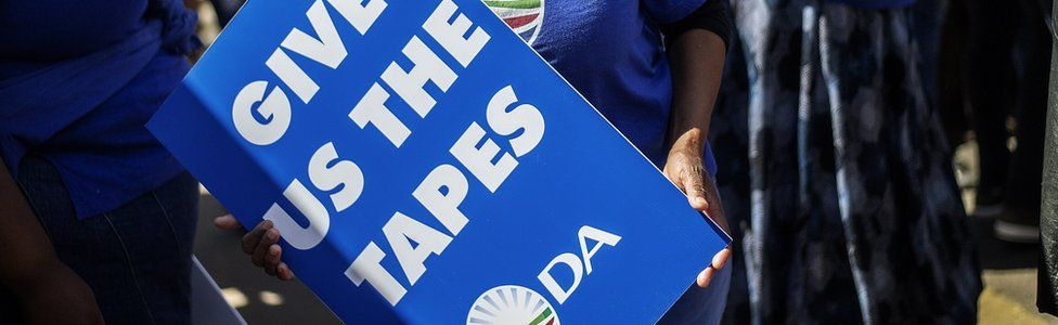 """A DA supporter holding a placard in 2014 reading: """"Give us the tapes"""""""