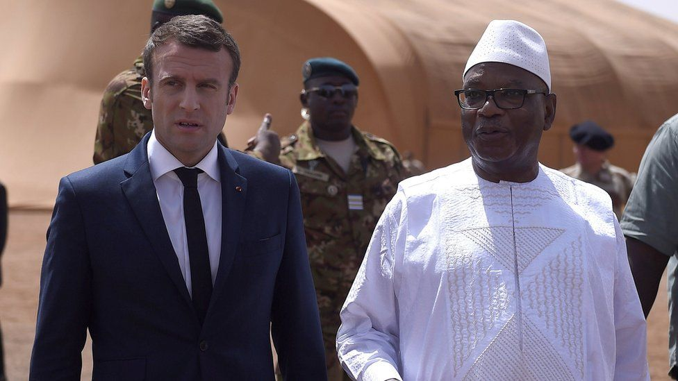 French President Emmanuel Macron (L) talks with Mali's President Ibrahim Boubacar Keita (R) during a visit to the troops of France's Barkhane counter-terrorism operation in Africa's Sahel region in Gao, northern Mali, 19 May 2017