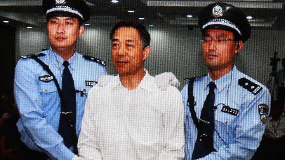 A screen shows the picture of the sentence of Chinese politician Bo Xilai (Center) on September 22, 2013 in Beijing, China. Th