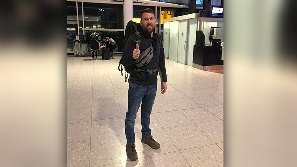 Alex Foulkes in airport