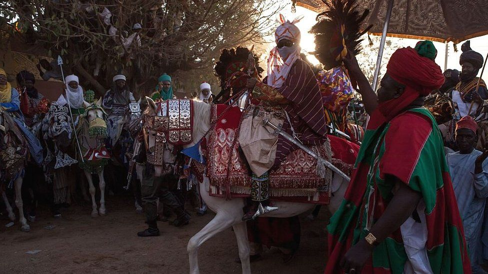Emir of Kano on horseback at a durbar for his coronation in 2014 in Kano, Nigiera