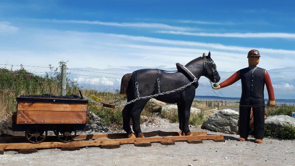 Sculpture of pit pony and miner at Point of Ayr Colliery