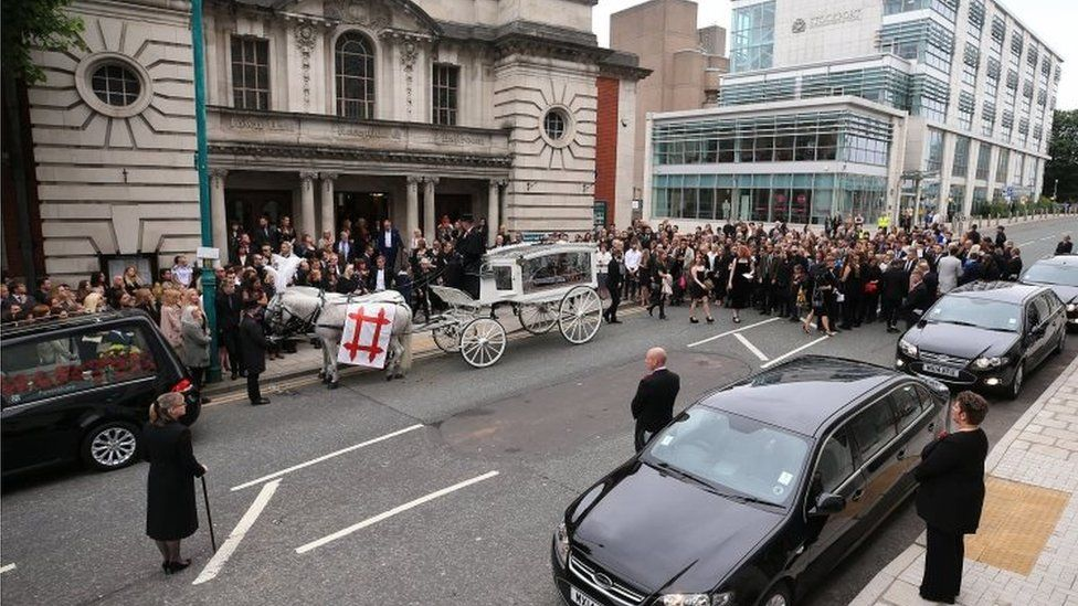 Crowds gathered to pay their respects