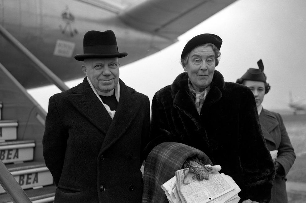 George Bell with Henrietta Livingstone at London airport, about to leave for Frankfurt in 1954