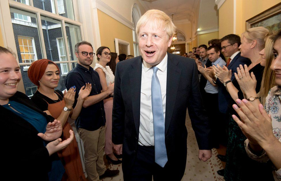 Boris Johnson greeted by staff at 10 Downing Street