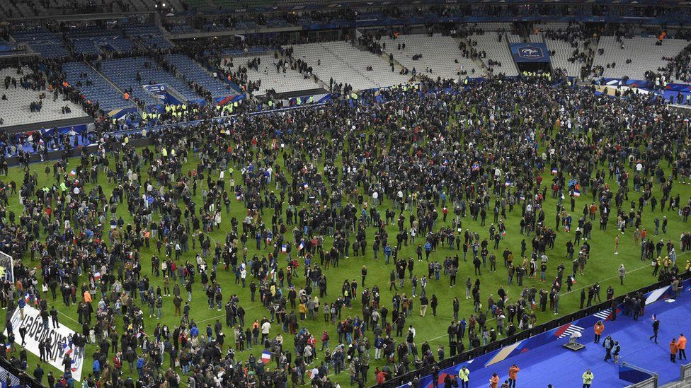 Spectators crowded onto the pitch