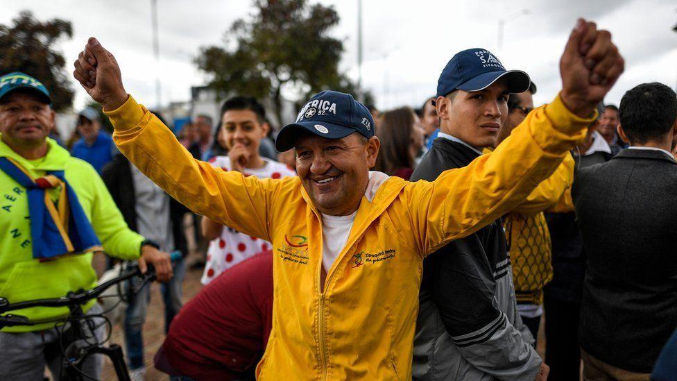 Colombian cycling coach Fabio Rodriguez - coach of Colombian cyclist Egan Bernal - celebrates as he watches the Tour de France in Zipaquira