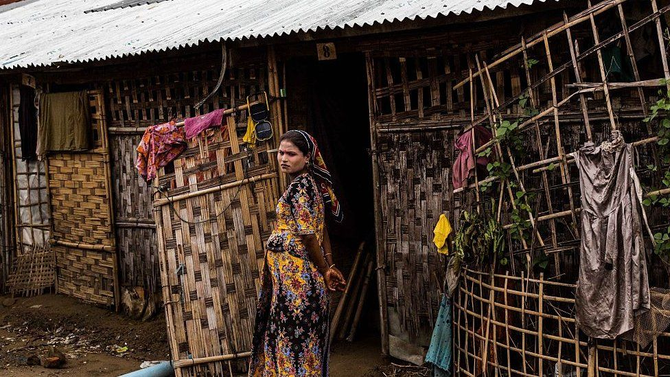 A Rohingya woman stands outside of her tent inside the IDP camps in Sittwe, Rakhine State Myanmar