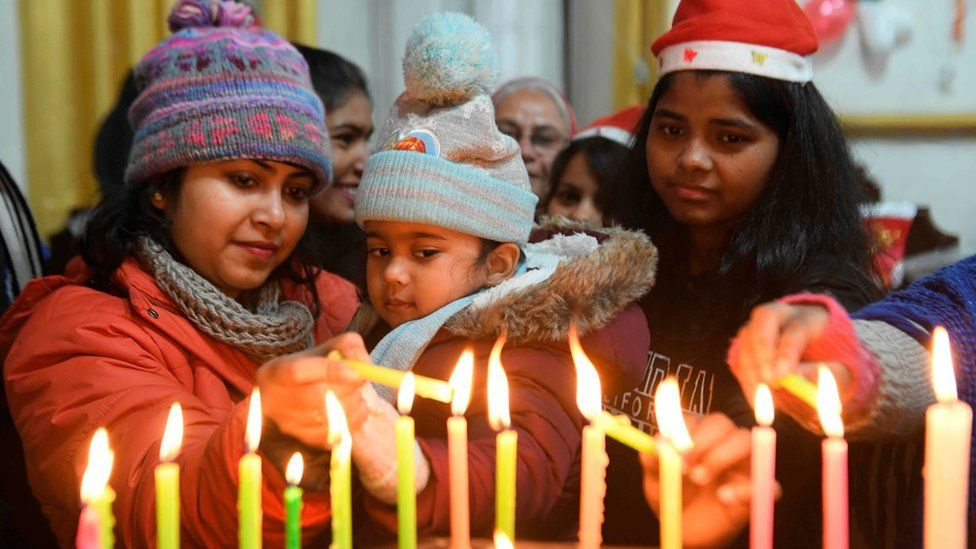 Christian devotees light candles on Christmas Day at St.Paul Church in Amritsar