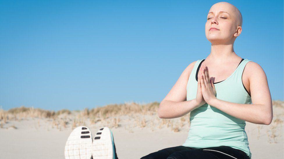 cancer sufferer doing yoga