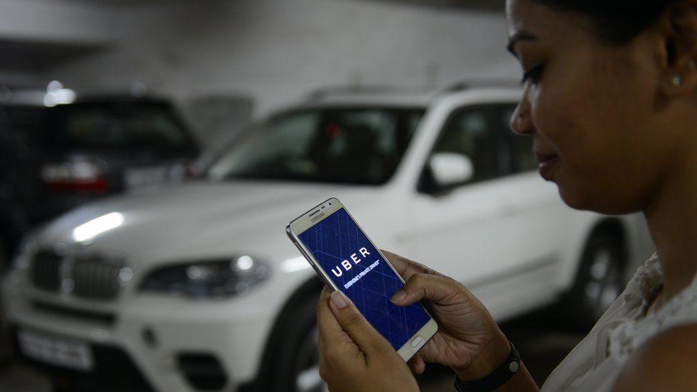 BENGALURU, INDIA - OCTOBER 01: UBER cabs booking using mobile app on October 01 2015 in Bengaluru, India.