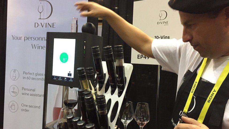 Man showing off D-vine wine dispenser