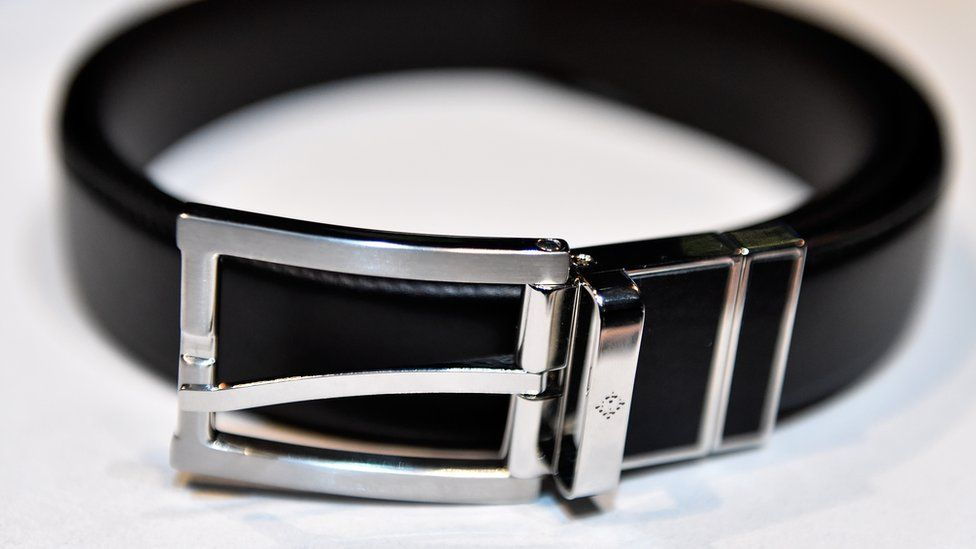A black belt with a metal buckle