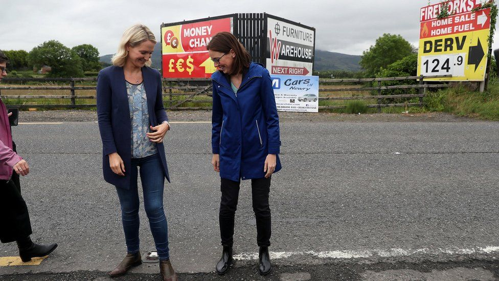 Irish minister Helen McEntee and the French Minister for Europe AmŽile de Montchalin stand on either side of the border on 19 July