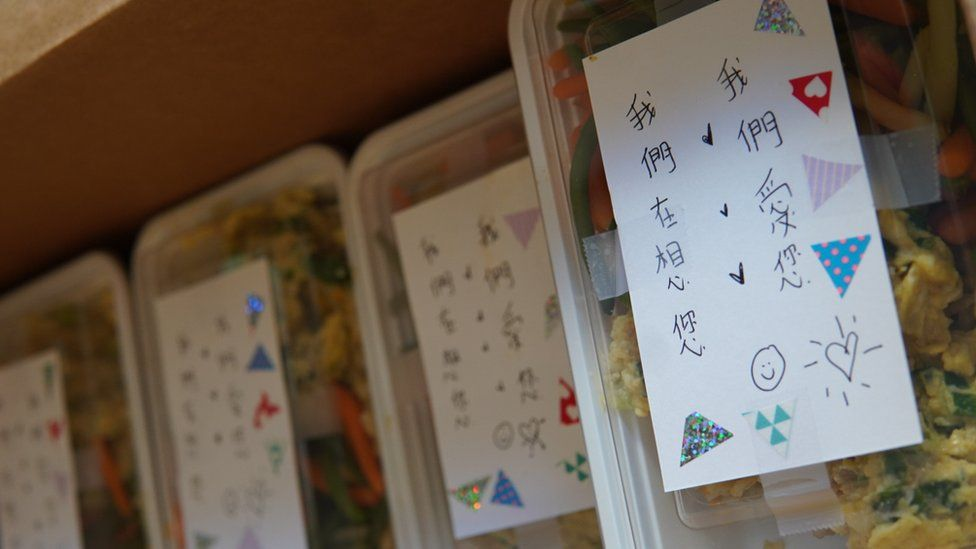 Chinese notes on top of hot food boxes