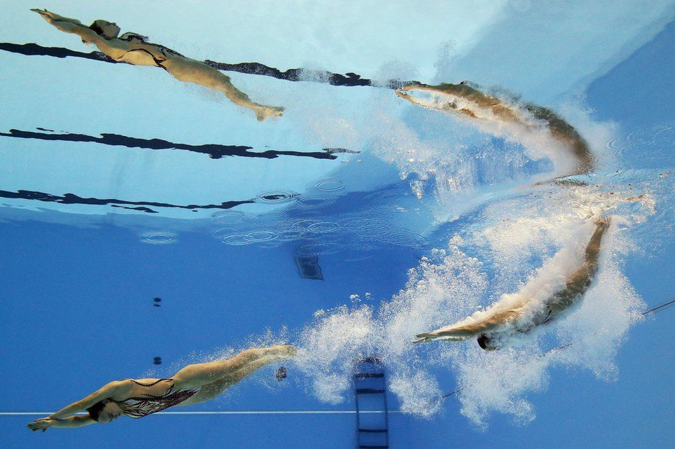 Kate Shortman and Isabelle Thorpe compete in a swimming pool