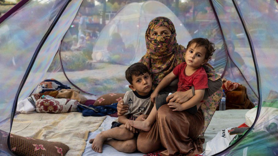 Farzia, 28, who lost her husband in Baghlan one week ago to fighting by the Taliban sits with her children, Subhan, 5, and Ismael ,2, in a tent at a makeshift IDP camp in Kabul