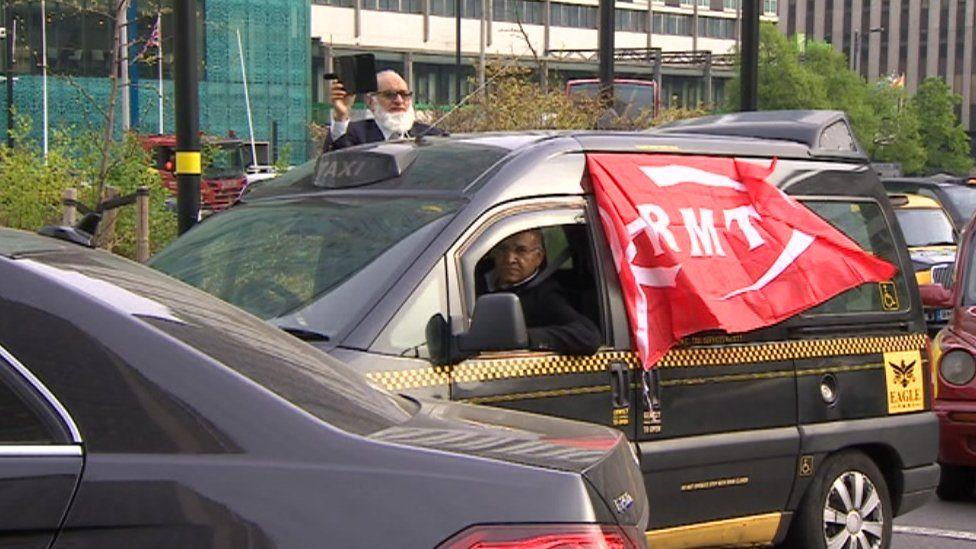 Taxi driver flying RMT flag in Birmingham traffic