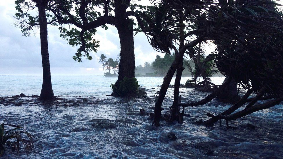 A file photo taken 3 March 2014 shows a high tide energised by storm surges washing across Ejit Island in Majuro Atoll, Marshall Islands