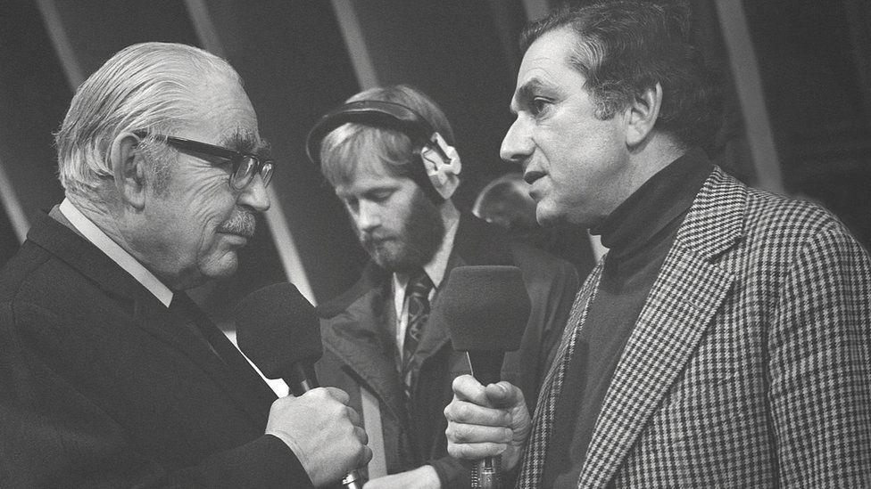 BBC radio broadcaster John Snagge interviews Sir Ken Adam