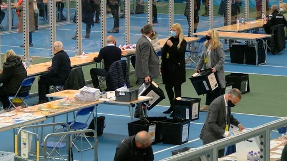 A socially-distanced count with ballot boxes