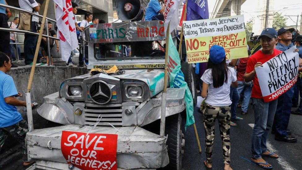 Demonstrators protest against an alleged government plan to phase-out old jeepneys
