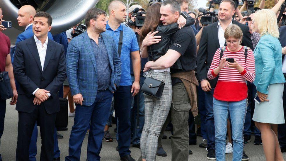 Олег Сенцов с родственницей и президент Зеленский