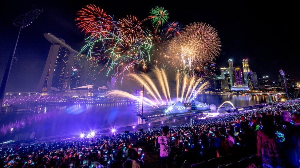 Fireworks explode over the Marina Bay at the stroke of midnight in Singapore, 1 January 2019