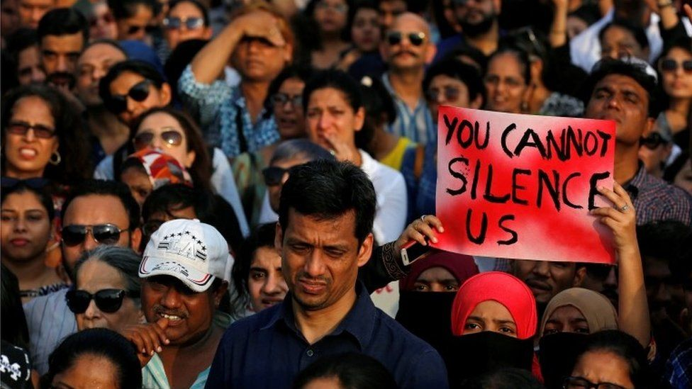 A woman holds a placard as she participates in a protest against the rape of an eight-year-old girl in Kathua near Jammu, and a teenager in Unnao, Uttar Pradesh state, in Mumbai, India, April 15, 2018