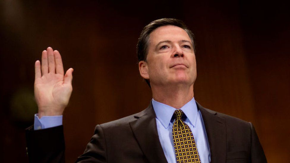 FBI Director James Comey is sworn in before testifying to a senate committee.