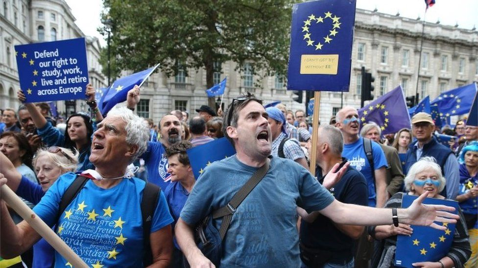 Demonstrators on an anti-Brexit March for Europe hold EU flags as they march to Parliament Square in central London