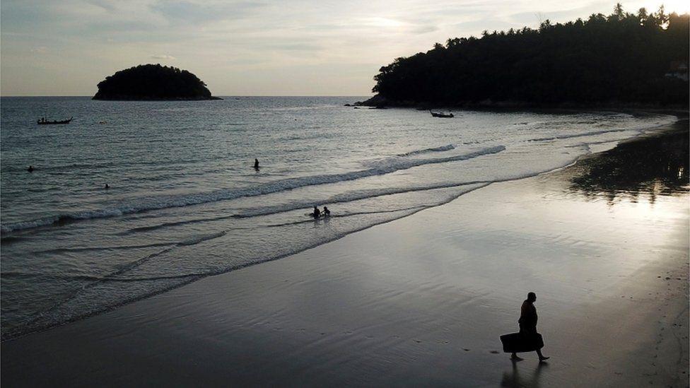 Tourists on a beach in Phuket, Thailand