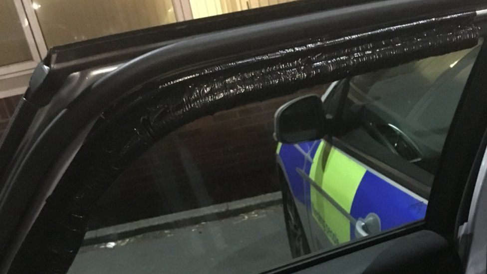 Duct tape on a police patrol car