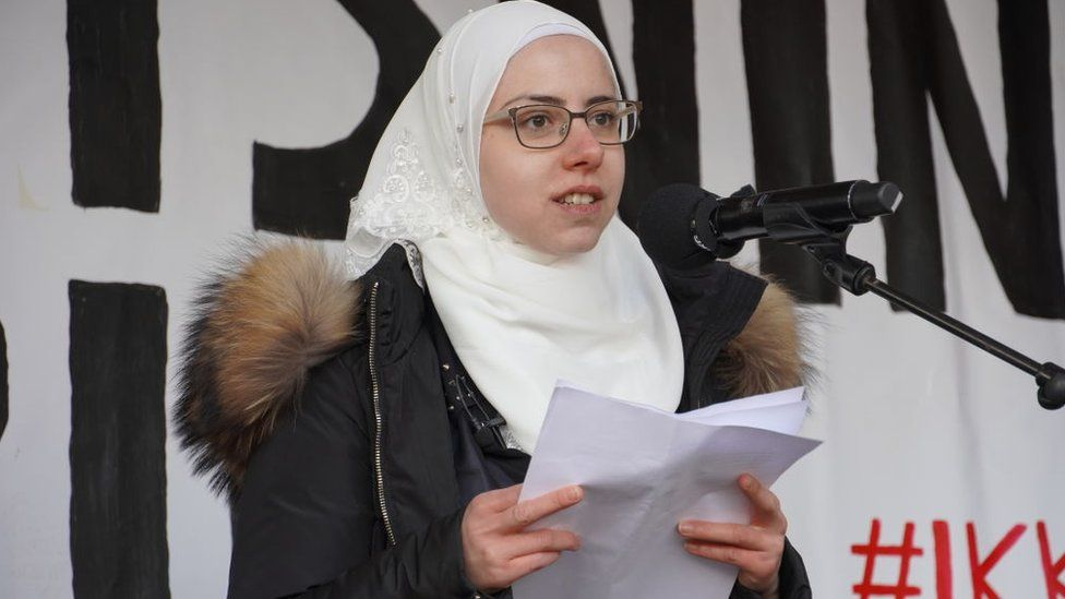 Faeza Satouf speaks during protest the government's plan to deport Syrian refugees