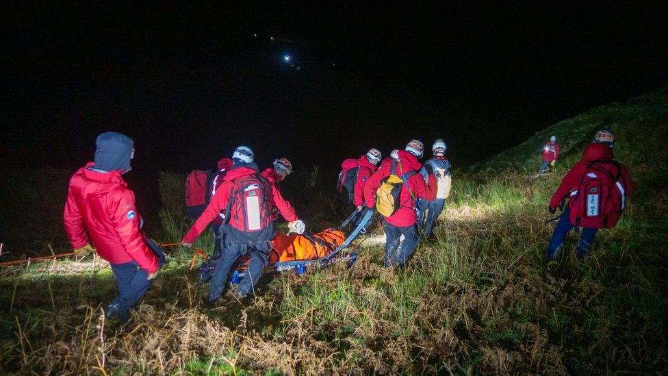 Man being stretchered to safety