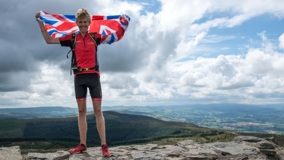 Alex Staniforth at the summit of Moel Famau