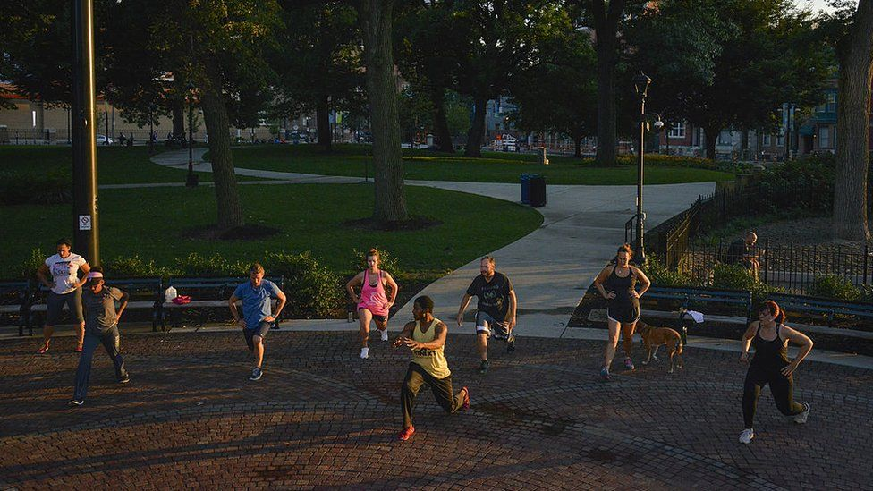People exercise in Washington Park in the Over-The-Rhine neighborhood
