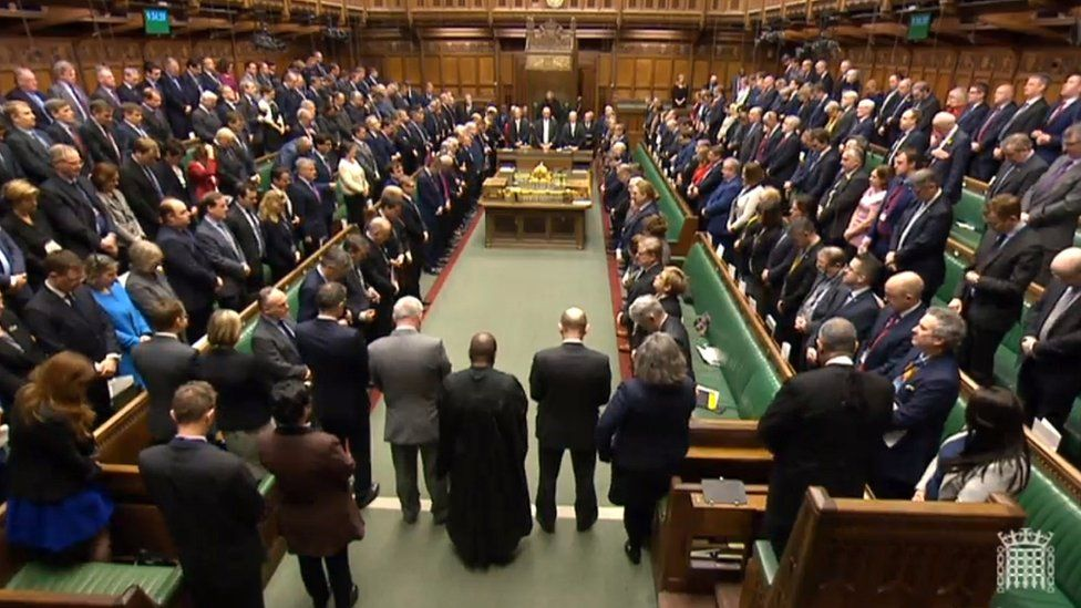 Members of the House of Parliament observe a minute's silence