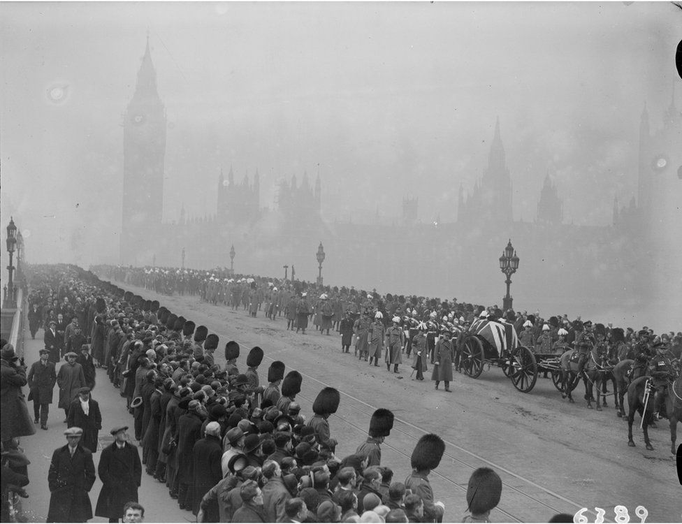 The funeral procession of Earl Haig, the gun carriage bearing his coffin is draped with a Union Jack and soldiers in bearskins line the pavements.