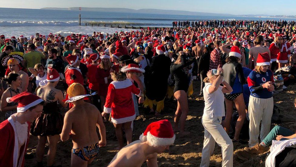 Christmas dip in the sea in Christchurch, Dorset.