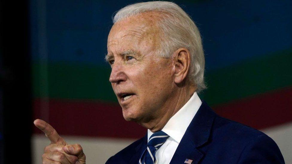Side view of Joe Biden giving a speech