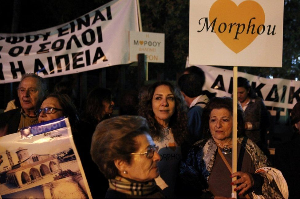 Displaced Greek Cypriots from the town of Morphou stage a protest outside the presidential palace in Nicosia during peace talks underway to resolve the decades-old conflict on the ethnically split island, Cyprus