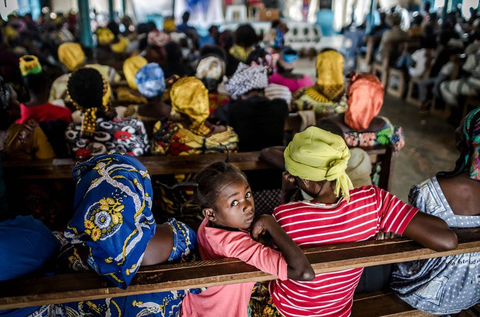 A girl looks on during a protestant Christmas cult in the Baptist Community of the Congo River in Loma, near Mbanza-Ngungu, Democratic Republic of Congo, on December, 25, 2018