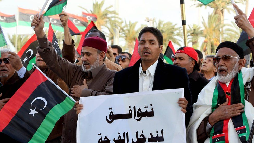 Libyans take part in a protest in Tripoli against the UN-backed unity government on 25 March 2016