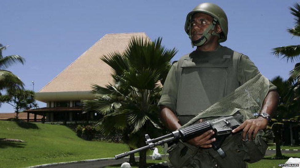 Fiji military soldier stands guards at the parliament building in Fiji's capital Suva