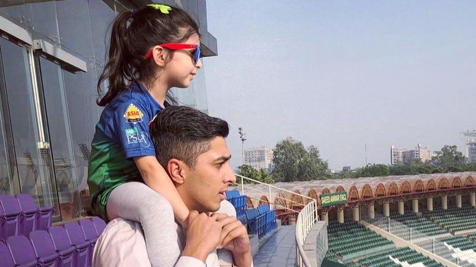 Ali with his daughter