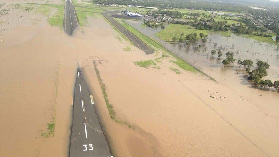 Floods cover a runway at Rockhampton Airport