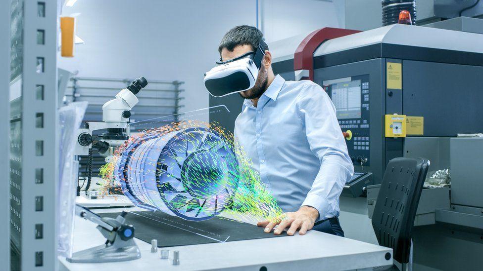 Man wearing VR headset looking at virtual turbine