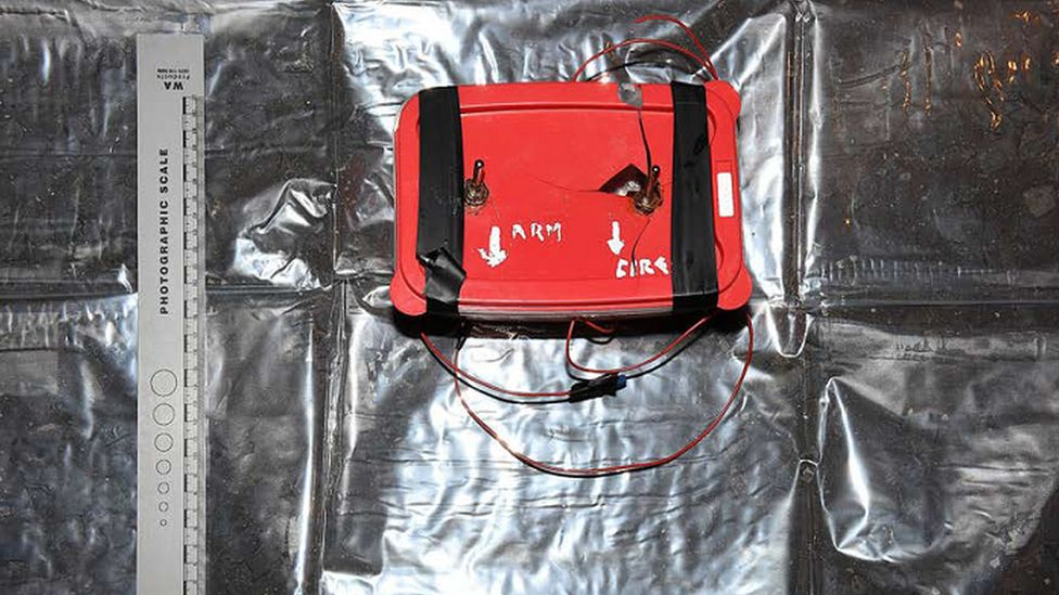 A crudely made bomb is contained within a plastic box
