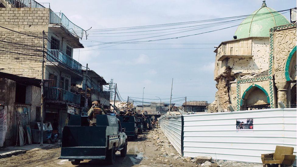Iraqi special forces patrol the Old City of Mosul